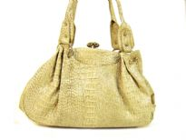 Croco Embossed PVC Fashion Handbag has a kiss lock closure and a double handle.