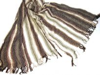 Off-white 100% viscose scarf with striped pattern in brown color. Little eyelash fringes along the length of scarf and threads like along the width of the scarf. Imported.