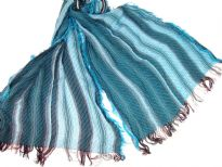 Turquoise colored viscose scarf with striped pattern in brown & white colors. Little eyelash fringes along the length and threads like at the edges of the scarf. Imported.