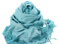 Crinkled & ruffled teal colored scarf with shiny silver patch running vertically in the middle and also mesh pattern bordering it. Fringes on the ends completes this stylish scarf. Imported.
