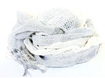 Crinkled & ruffled light hued scarf in white color with shiny off-white color running vertically through it in the middle. Fringes on the ends completes this stylish scarf.