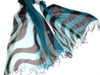 Lightweight Shaded Polyester scarf in shades of Teal Blue with Black waves over it. Fringes on its ends. Imported.