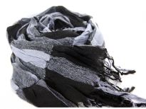 Checkered black & grey 100% polyester woven scarf which is crinkled as well as stretchable. Silver lining running through the scarf vertically. Twisted fringes on its ends. Hand wash. Imported.