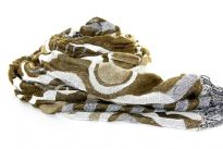 This artistically patterned 100% Polyester scarf in shades of olive is quilted and super soft to use. This retro scarf can be teamed with any kind of outfit. Thin fringes on the edges adds that extra zing to it. Imported.
