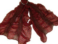 This checkered print red & black 100% polyester scarf can be a perfect accessory all year round. The scarf is stretched in the middle with striped pattern also & gives a ruffled look. Imported.