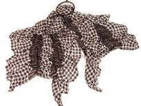 This checkered print black & white 100% polyester scarf can be a perfect accessory all year round. The scarf is stretched in the middle so gives a ruffled look. Imported.
