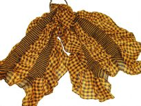 This checkered print mustard & black 100% polyester scarf can be a perfect accessory all year round. The scarf is stretched in the middle with a striped pattern & gives a ruffled look. Imported.