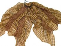 This checkered print 100% polyester scarf in light brown can be a perfect accessory all year round. The scarf is stretched in the middle with a striped pattern & gives a ruffled look. Imported.