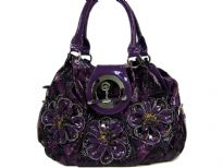Triple flower applique animal print fashion Handbag with zipper closure & flap closure over it also.