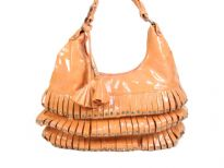 PVC fashion Hobo Handbag has studded details has a metallic texture, a top zipper closure, and a single strap. Made of faux leather.