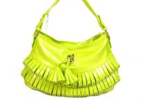 Fashion shoulder bag has a top zipper closure, a single strap and layered frill with stud details on it. Made of PVC.