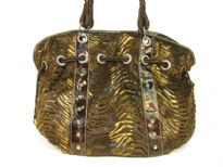 Designer Inspired metallic animal print velvet shoulder bag with drawstring detail. Bag has a zipper closure and a double strap. Made of PU (polyurethane).