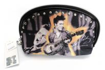 Elvis Presley cosmetic bag has zipper and is made from fabric.