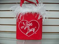 I Love Lucy Bucket Bag with fury feather like accnets. Bag has a double handle. Made of PU (polyurethane).