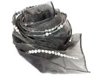 This sheer scarf in deep charcoal color is embellished with vertical stripes of sequins. Mirror embellishments also in between vertical stripes of sequins. 100% shiny polyester scarf is very lightweight. Hand wash. Imported.