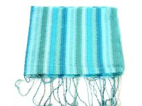 Multi Colored Stripes in shades of turquoise & green colors spread over this lightweight & long scarf. Stitches like embroidery all along the stripes decorates this little shiny 100% polyester scarf. Long twisted fringes on its ends. Imported. Hand wash.