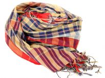 Navy colored plaids print covers this shiny gold colored 100% polyester scarf. Red border along the vertical edge of scarf & thin twisted fringes at the edges. Imported. Hand wash.
