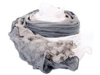 Triple Tone Crinkled 100% Polyester Scarf in shades of grey, silver & white. Crinkled vertically with circular crinkles on both the ends. This sumptuous scarf is appropriate all year around with any kind of outfit. Imported.