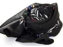100% polyester scarf in floral design. Main color in Black. Hand washable. Size is approximately 72x40 inches. Made in India.