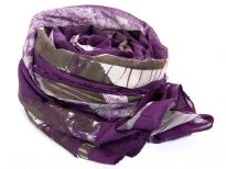 This Purple with Grey & Beige tones 100% polyester scarf has an abstract background with skulls print on it. Purple border all around & eyelash fringe along both its lengths. Imported. Hand wash.