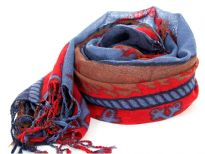 Nautical symbology floats over this 100% wool scarf in blue, red & brown colors. The scarf has boats & anchors print with fringes at the ends. Hand wash. Imported.