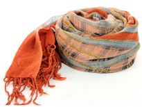 This Rust scarf has checkered print in the middle with tussels and Ropes running around it. The borders of the scarf are plain rust color with long fringes decorating the ends. 100% wool scarf. Imported. Hand wash.
