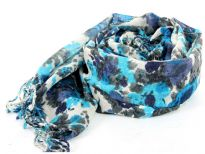 Venetian Blues saturate the lush floral print on a super soft, fringed wool scarf in Ivory color. Imported. Dry clean only.