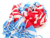 The British flag patterns this finely woven, lightweight wool scarf in ivory, turquoise & red colors with twisted fringe at the ends of the scarf. Imported from India. Dry clean only.