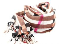 Long twisted fringe decorates the ends of a sumptuous wool scarf updated in an array of colors to match your every mood. Brown, fuchsia & black plaids over beige colored scarf. Imported. Dry clean only.