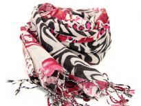 This beige colored wool scarf has alternate waves of leopard and zebra print pattern in black & fuchsia colors with little bit of floral print also. Long twisted fringe at the edges. dry clean only. Imported.