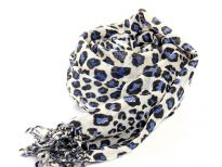 Black & blue leopard spots enliven this ivory colored scarf cast in 100% wool. Decorated with twisted fringe at the ends. Imported. Dry Clean only.