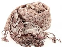This lightweight & cozy light natural colored wool scarf is patterned with the trendy python print & twisted fringe decorates its edges. Imported. Dry clean only.