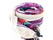 Add a punch of color with this black vivid wool scarf patterned with floral design in blue, red & purple colors and cream colored border along the vertical length. Hanging fringe decorates the ends. 100% woolen scarf. Hand wash. Imported.