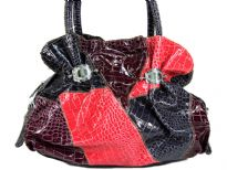 PVC handbag in multi colored patchwork with double shoulder handle, zipper closure.