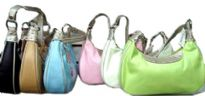 Lightweight handbag for your every use has a touch of sparkle along closure. Bag has a single strap, a top zipper closure and outside pocket with zipper closure. Made of faux leather.