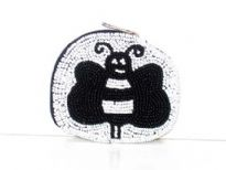 Beaded oval coin purse with bee shape pattern on it. Top zipper closure with wrist strap. Imported.