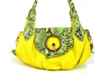This handbag has crocodile embossed flap over the top zipper closure which has a toggle closure and a double handle. Made of PU (polyurethane).