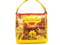 Designer Inspired croco embossed printed bucket handbag with zipper closures and single strap. Bag has an abstract floral pattern design as well as small belt detials. Made of PVC.