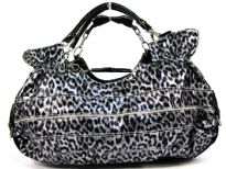 This handbag is made of polyurethane material. It has a cheetah animal print and a top zipper closure with double handle.