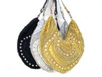 Beautiful hand beaded evening bag with mirrors & beads of different shapes. Top zipper closing with single shoulder strap.