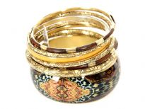 Beautifully designed 7 piece fashion bangles set has printed wide cuff bangle with gold plating, 3 gold colored bangles, 2 thin brown/gold bangles & 1 yellow resin bangle. Each of the bangles has their own etched design.