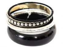Black & silver colored 5 piece bangle bracelet set has one wide resin bangle, one rounded silver bangle, silver bangle with  studs design & 2 thin black fabric bangles. Matches with almost any kind of outfit to give that funky look.