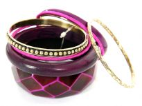 Rich colored attractive 8 piece bangles set has wide cuff diamond pattern bangle, one rounded wooden bangle, 2 fabric bangles, 1 purple resin bangle & 3 gold color each having its own etched design. Hand crafted by experts in India.