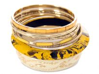 "Artistically designed 7 piece fashion bangles set has one ivory 2.5"" diameter bangle with gold etched design, yellow/black paint wooden bangle& 5 thin bangles with its own etched design. Lightweight & durable costume jewelery set can be worn with any kind of outfit."