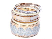 Beautifully designed seven piece set includes ivory wide cuff bangle with artistic floral print in silver, another ivory bangle in aluminium with box pattern, 2 more ivory  bangles with silver inside & 3 thin silver twisted bangles.
