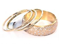 Beautifully designed 4 piece bangles set which has one wide cuff ivory bangle with gold etched design, 2 plain gold colored bangles & a pearls bangle. Gives a classic touch to any kind of outfit & very lightweight.