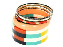 Artistically designed colorful set can be matched with number of outfits any time of the day. 7 piece bangles set includes one wide cuff colorful bracelet, one peach rounded bangle, 3 thin black bangles & two ivory/gold resin bangles.