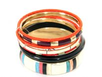 Beautifully designed 7 piece fashion bangles set has one wide bangle in ivory with triple colored stripes pattern, 2 fabric thin bangles & 4 resin bangles in different colors/design. matches with number of outfits any time of the day.
