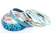 Sober yet artistic 6 piece bangles set has animal print wide cuff bangle, one rounded resin bangle, 2 fabric bangles & 2 colored - one is simple &  other has carved design. Designed & crafted by expert artisans.