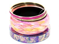 Funky four piece wide bangles set includes abstract print wide cuff bangle in pink/yellow, teal colored thick bangle with fuchsia/gold glitter & two bangles in fuchsia/gold colors.